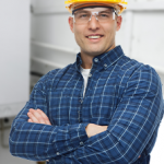 Smiling HVAC technician in crossed hands