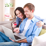 Man and woman comfortably sitting on sofa